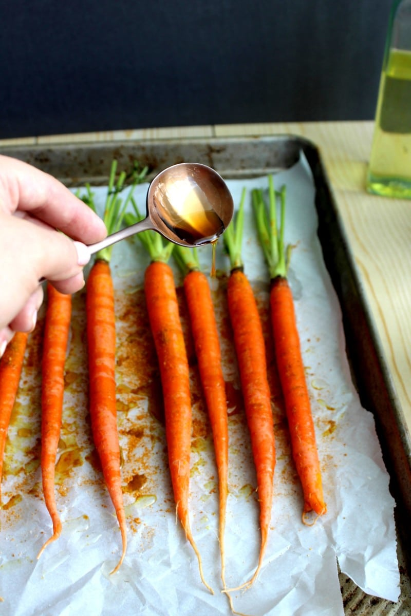 Add Parchment Paper To Your Baking Sheet And Add The Carrots Next, Drizzle  The Carrots With The Olive Oil And Maple Syrup Lastly, Sprinkle The Spices